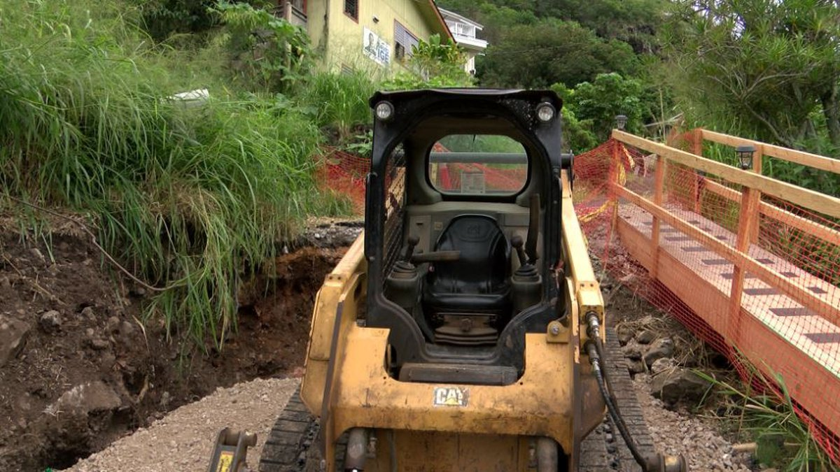 Despite the city's attempts to condemn properties and reinforce the hillside, residents in...