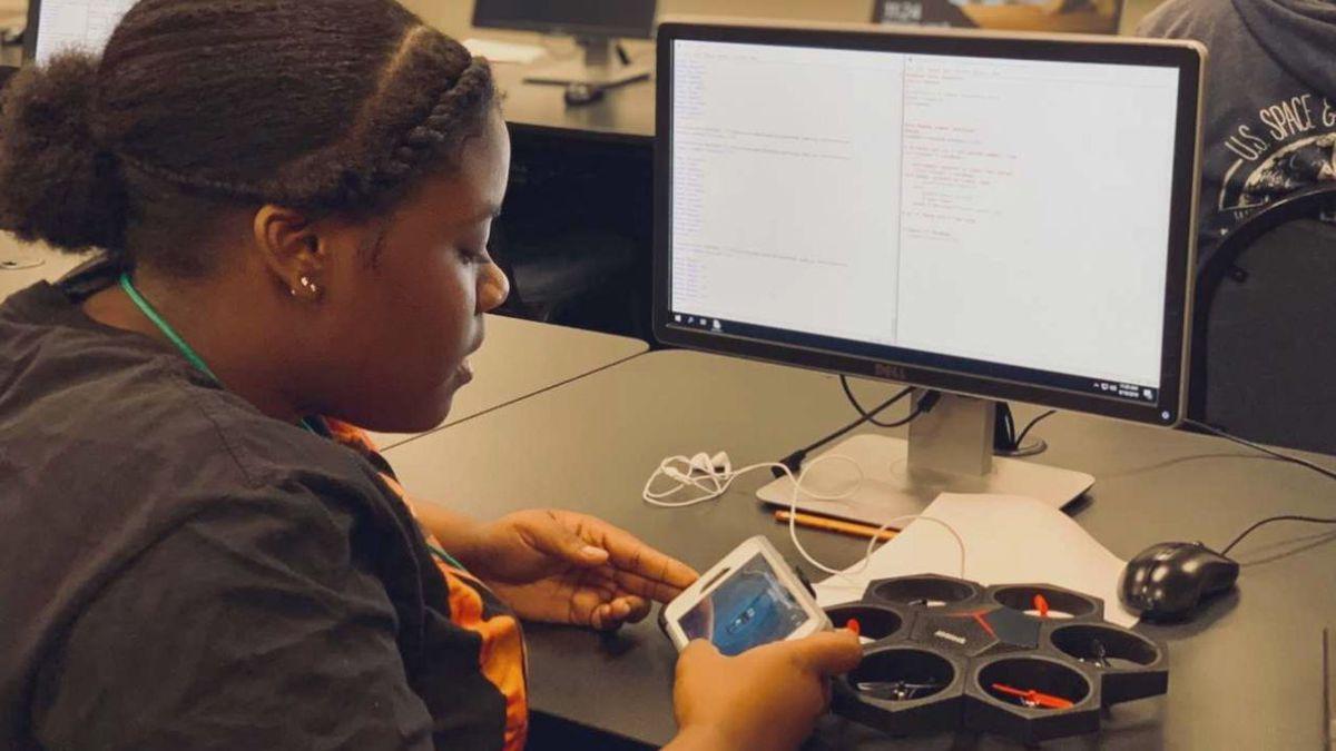 High school student working on programming.