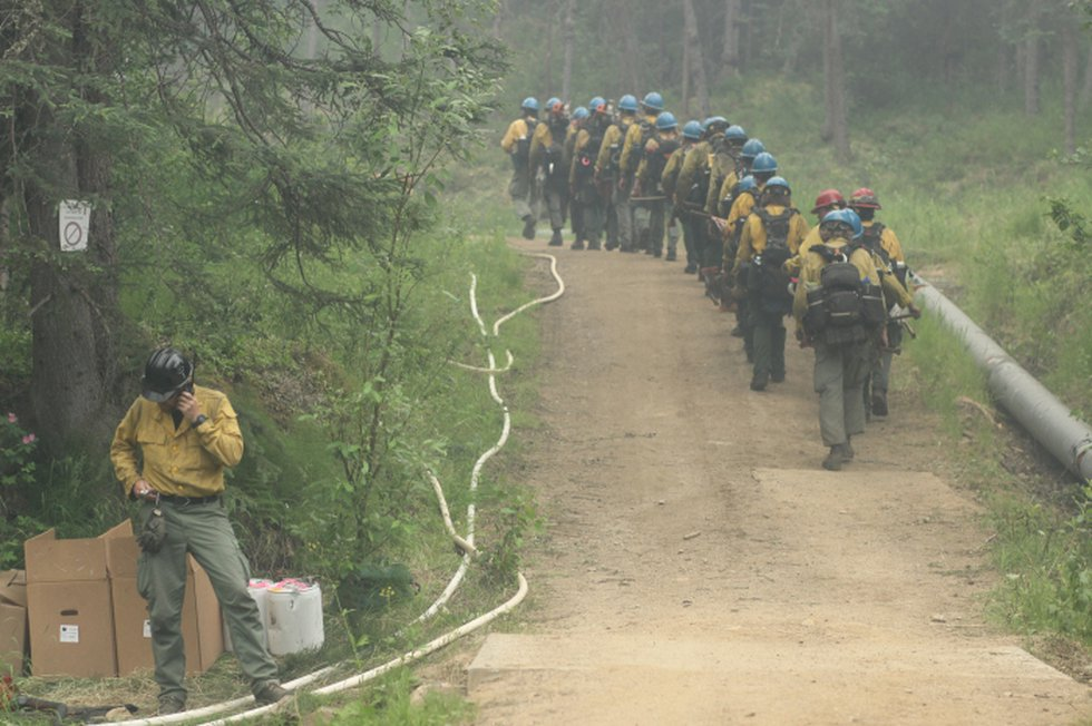 The UAF Nanooks Crew marches up a road to assist with a burnout on a road east of Chena Hot...