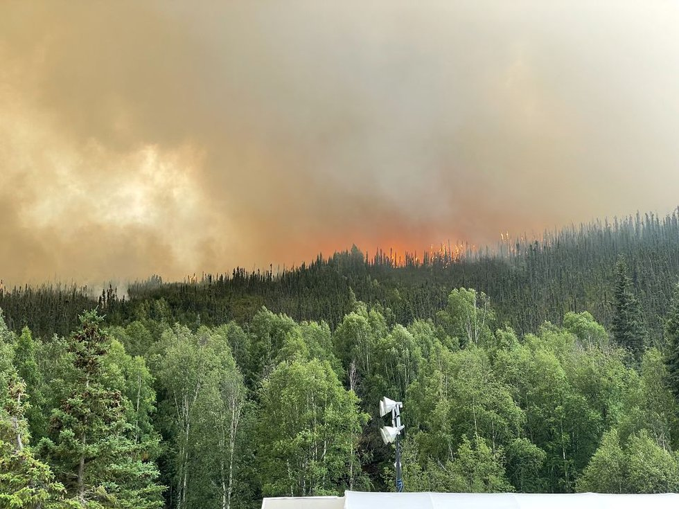 Flames from the Munson Creek fire creek over the hillside toward Chena Hot Springs Resort on...