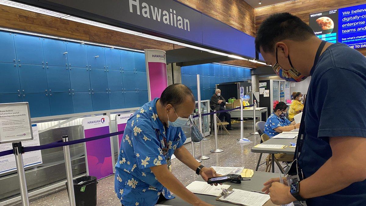 Inter-island passengers go through screenings at Honolulu's airport.