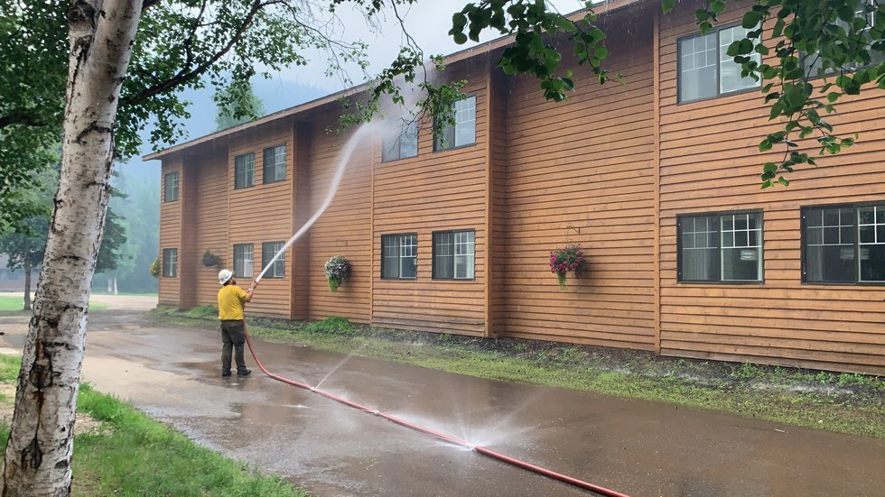 Logistics Section Chief Dane Smigleski sprays down a building at the Chena Hot Springs Resort...