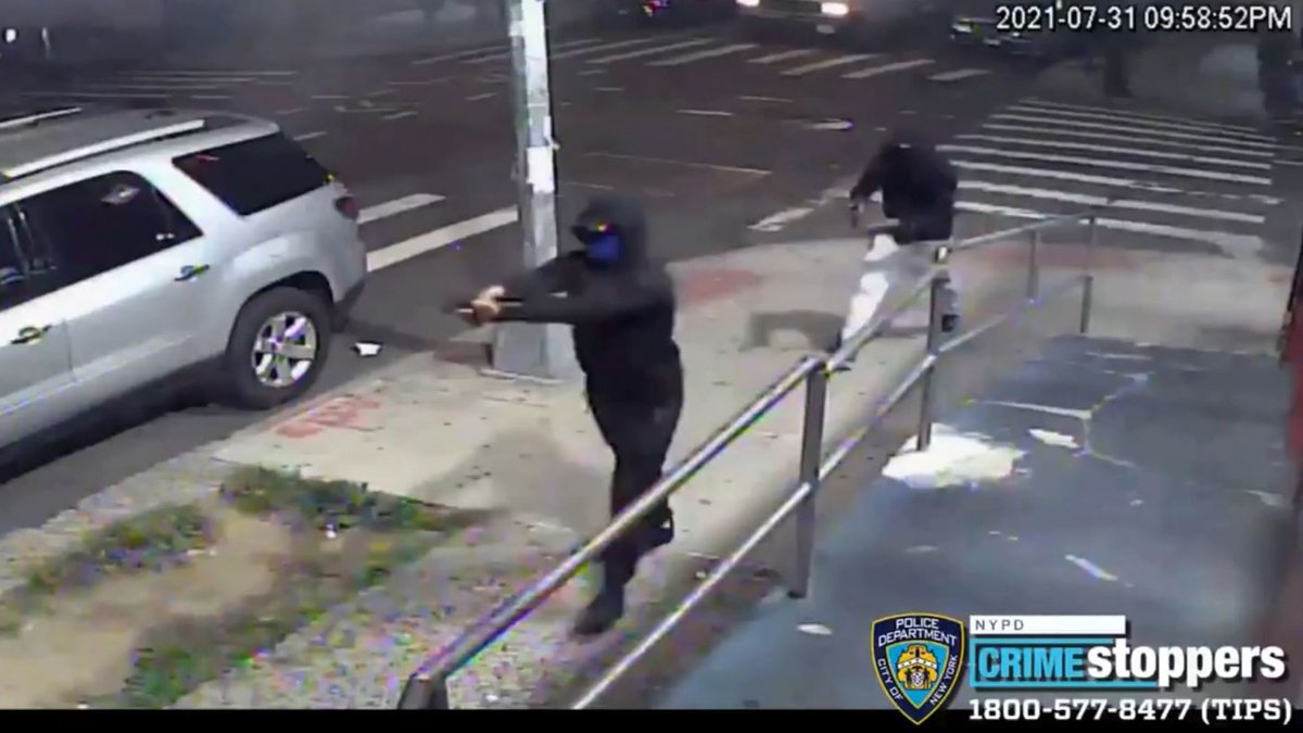 This image from surveillance video shows the suspects in a mass shooting in New York City that...
